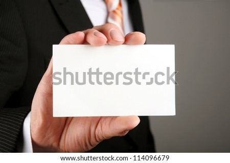 business man showing blank business card or sign