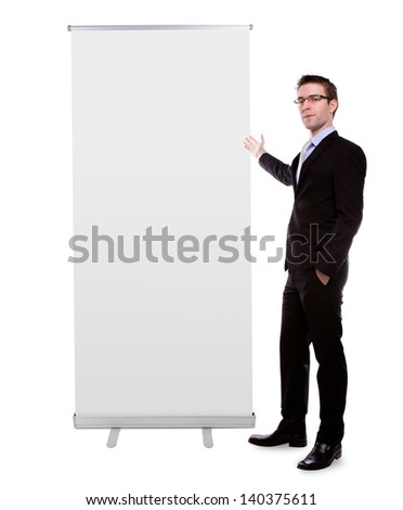 Business man showing Blank roll up banner display isolated on white background - stock photo