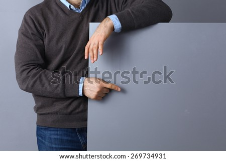 Business man showing blank signboard - stock photo