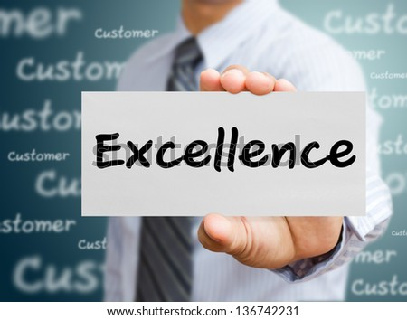 business man showing concept of excellence - stock photo