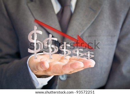 Business man showing dollars sign graph