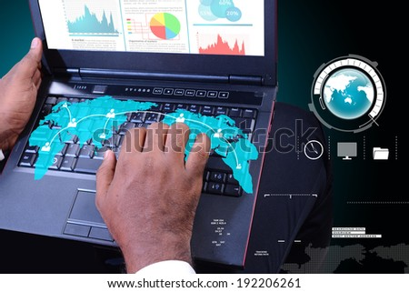 Business man showing financial report in laptop - stock photo