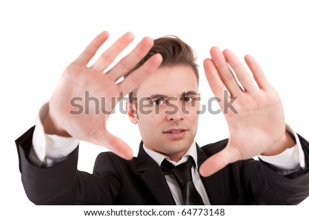 Business man showing framing hand gesture - isolated on white - stock photo