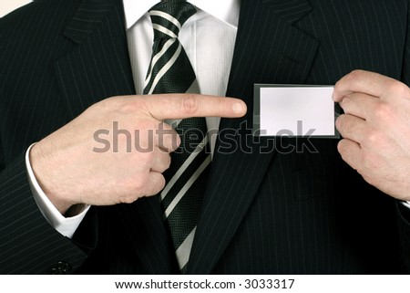 Business man showing his blank namebadge - insert your own brand and information - stock photo