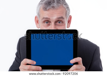 Business man showing modern tablet, touch pad, new technology - stock photo