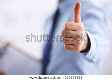 Business man showing ok, hand with thumb up - stock photo