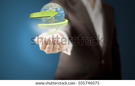 Business man showing realistic globe with green arrow around the world for eco and recycle concept. Elements of this image furnished by NASA. - stock photo