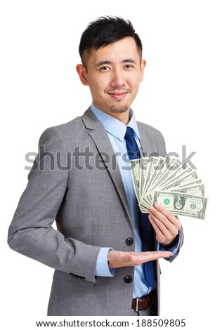 Business man showing spread of Cash - stock photo