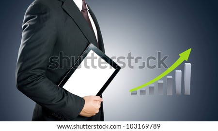 Business man showing tablet PC with green growth graph background