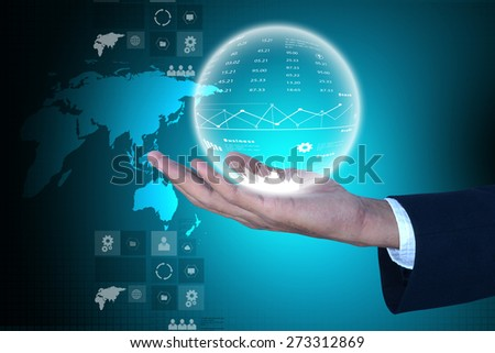 Business man showing the globe - stock photo