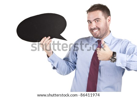 business man showing thumbs up while holding a speech balloon - stock photo