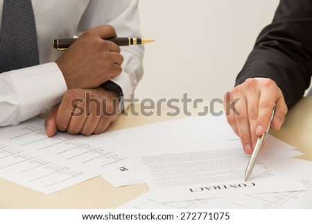 Business man signing a contract. - stock photo