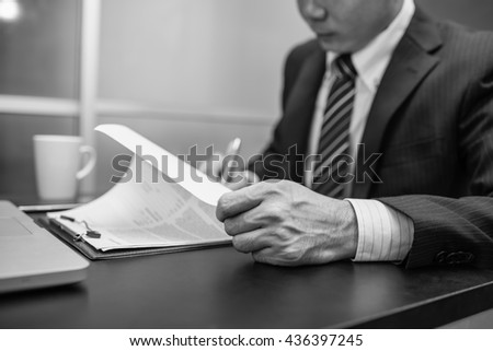 Business man signing a contract  . Close-up photo ,  black and white - stock photo