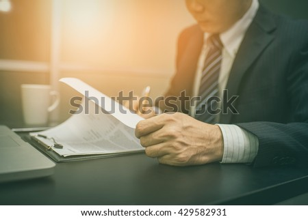 Business man signing a contract  . Close-up photo , vintage tone.  - stock photo