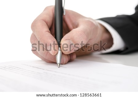 Business man signing a contract. Shallow depth of field. - stock photo