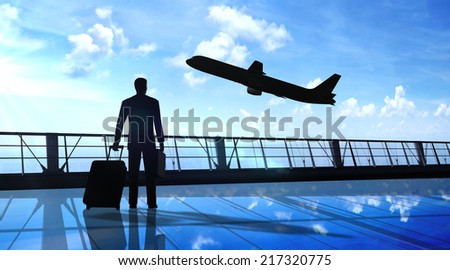 Business man silhouette in the airport - stock photo