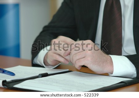 business man sitting at a board room table during a  meeting