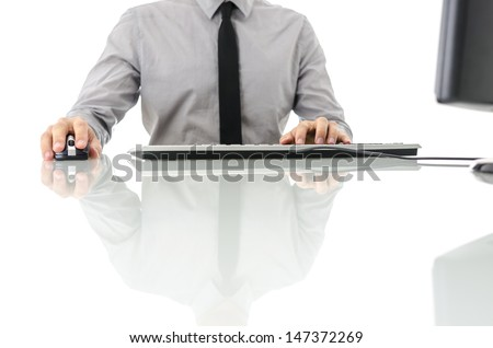 Business man sitting at his office desk using computer. - stock photo