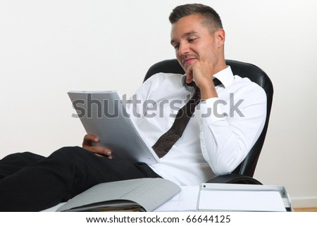 business man sitting at table in the office