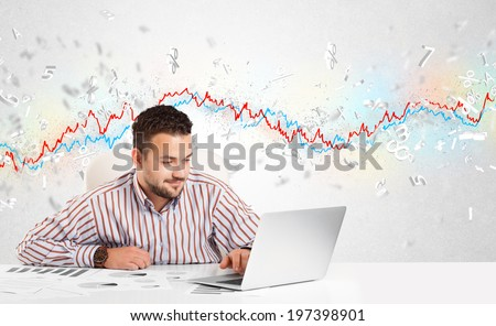 Business man sitting at table with stock market graph 3d letters - stock photo