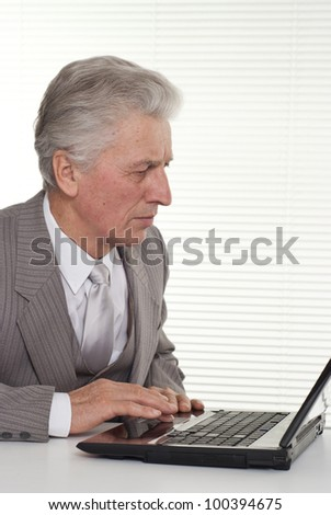 Business man sitting at the computer on a light