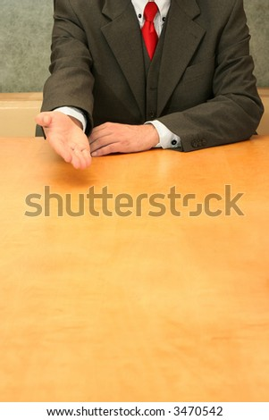 Business-man sitting at the desk, talking about something. - stock photo