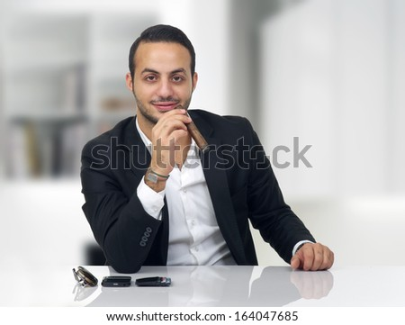 Business man sitting in his office and smoking cigar
