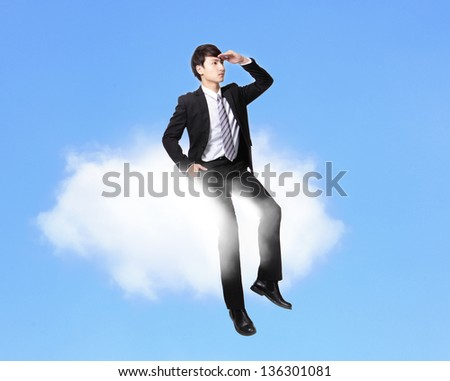 business man sitting on a cloud and look to empty copy space over blue sky in full length, asian male model