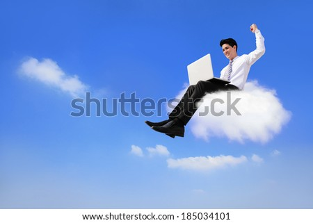 business man sitting on a cloud working with laptop, low angle view, cloud computing concept - stock photo