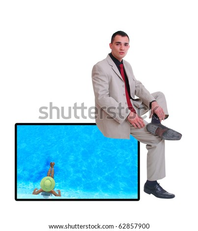 business man sitting on a tv screen over a white background - stock photo