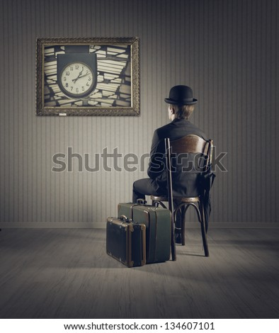 Business man sitting on old chair,  checking time for his travel - stock photo