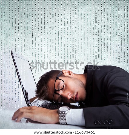 Business man sleeping on a laptop computer on a background full of numbers - stock photo