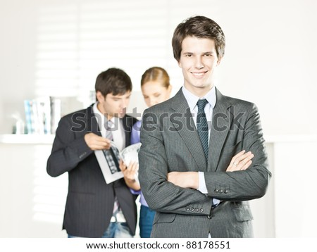 business man smiling, in an office - stock photo