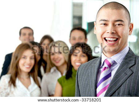 business man smiling leading a team in an office - stock photo