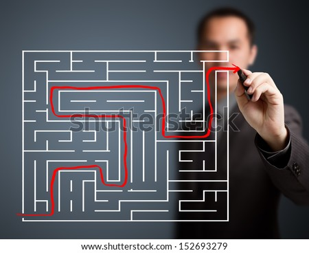 business man solved the maze - stock photo