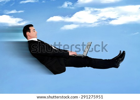 Business man speed fly using computer - stock photo