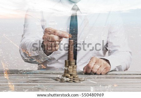 Business man stacking cash, double exposure with modern finance city background, real estate financing concept