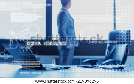 business man standing at window in working office with technology layer effect - stock photo