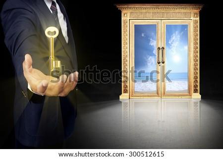 Business man standing front of big success key door, successful concept  - stock photo