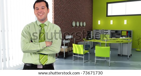 Business man standing in an office in green shades