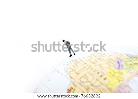 business man standing on earth - stock photo