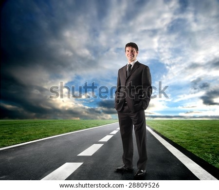 business man standing on the road - stock photo