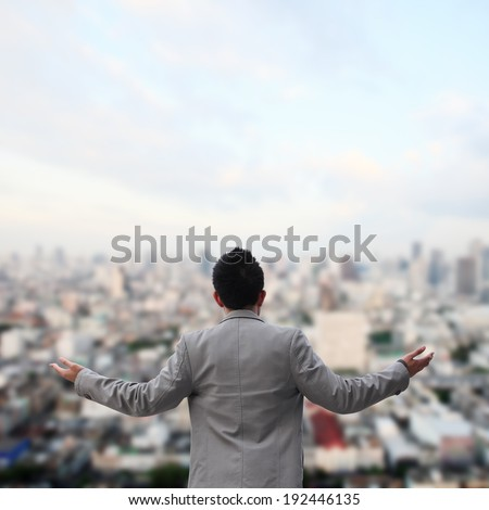 Business man standing with arms wide open  - stock photo