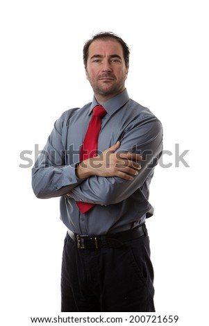 Business man standing with his arms crossed looking at camera - stock photo