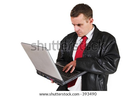 Business man standing with Notebook Computer