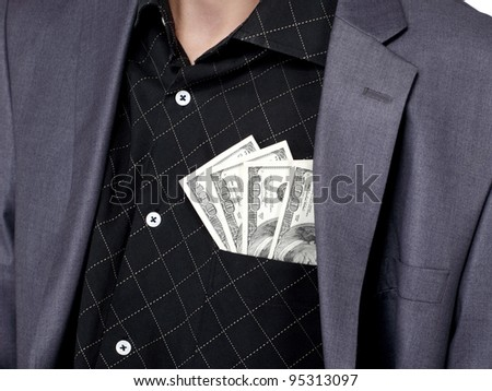 Business man standing with some american dollars in his shirt pocket, close up