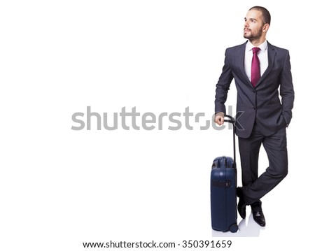 Business man standing with suitcase on white background - stock photo