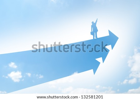 Business man stands on arrowhead and flies to sky. - stock photo