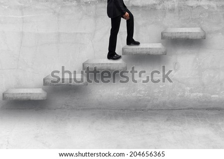 business man stepping up adder concrete idea concept for success and growth business - stock photo