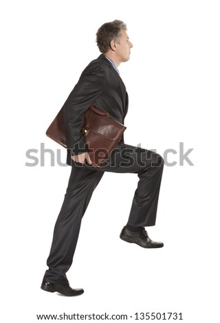 Business man stepping up - isolated over a white background